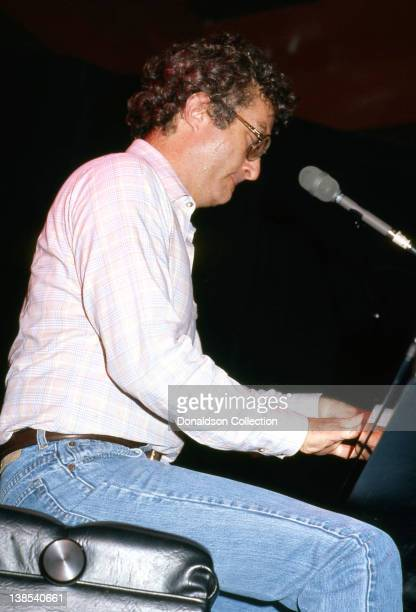 Songwriter Randy Newman performs at the piano in 1984 in Los Angeles California