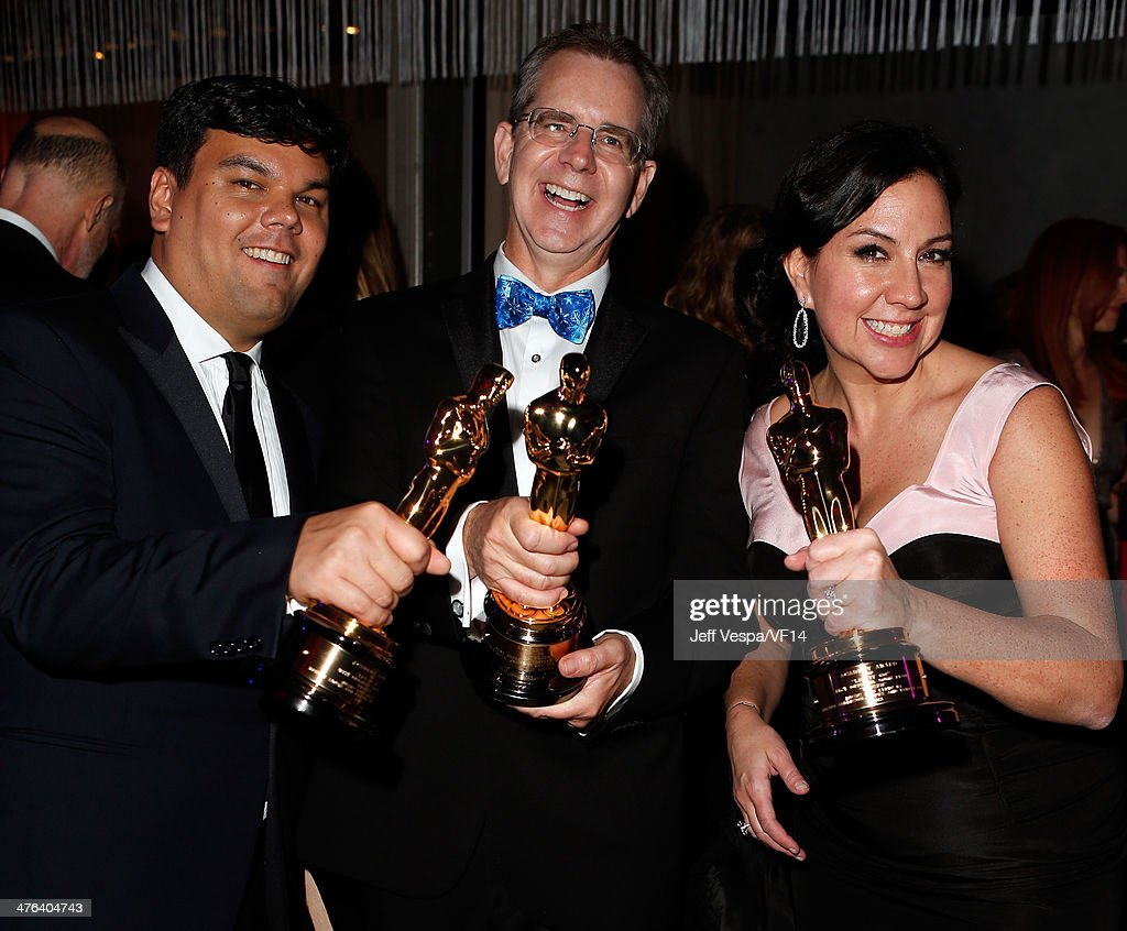 Songwriter <a gi-track='captionPersonalityLinkClicked' href=/galleries/search?phrase=Robert+Lopez+-+Composer&family=editorial&specificpeople=9655546 ng-click='$event.stopPropagation()'>Robert Lopez</a>, director <a gi-track='captionPersonalityLinkClicked' href=/galleries/search?phrase=Chris+Buck&family=editorial&specificpeople=1664952 ng-click='$event.stopPropagation()'>Chris Buck</a>, songwriter Kristen Anderson-Lopez attend the 2014 Vanity Fair Oscar Party Hosted By Graydon Carter on March 2, 2014 in West Hollywood, California.