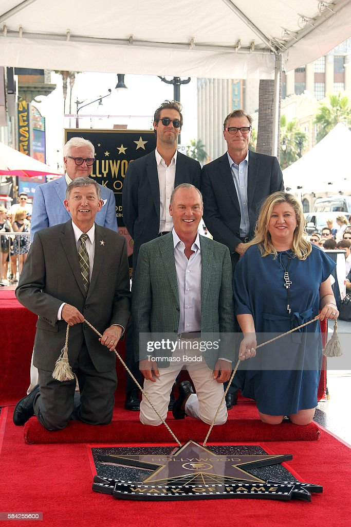 Songwriter Sean Douglas actor Michael Keaton screenwiter John Lee Hancock and CEO of the Hollywood Chamber of Commerce Leron Gubler attend a ceremony...
