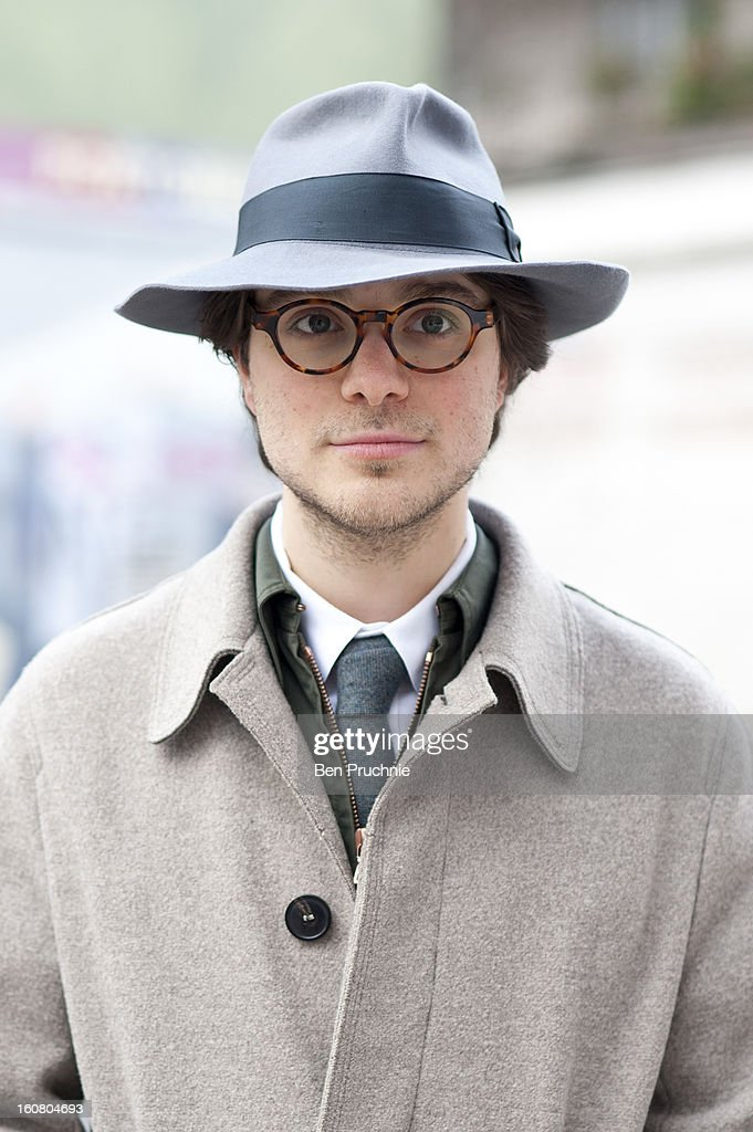 Songwriter Xavier (25) poses wearing a vintage fedora. Vivienne Westwood trousers with Roselli shoes, Mythic Classic glass and a jacket from Private White in Notting Hill on February 6, 2013 in London, England.