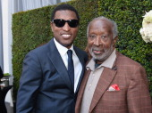 Songwriter/record producer Kenny 'Babyface' Edmonds and music producer Clarence Avant attend a ceremony honoring Kenny 'Babyface' Edmonds with the...