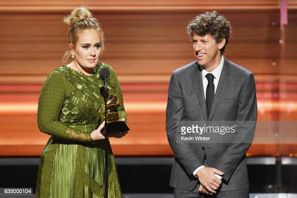 Songwriters Adele Adkins and Greg Kurstin accept the Song Of The Year award for 'Hello' onstage during The 59th GRAMMY Awards at STAPLES Center on...