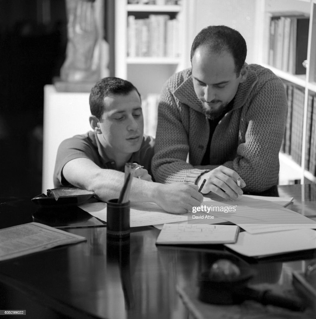 Songwriters and producers Jerry Leiber (R) and Mike Stoller pose for a portrait in Stoller's apartment in 1959 in New York City, New York.