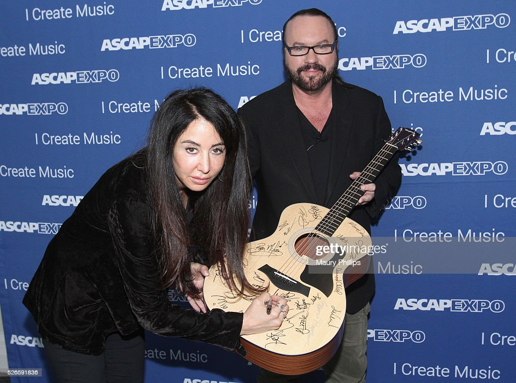 Songwriters Antonina Armato and <a gi-track='captionPersonalityLinkClicked' href=/galleries/search?phrase=Desmond+Child&family=editorial&specificpeople=745873 ng-click='$event.stopPropagation()'>Desmond Child</a> sign a #StandWithSongwriters guitar, which will be presented in May to members of Congress to urge them to support reform of outdated music licensing laws, at the 2016 ASCAP 'I Create Music' EXPO on April 30, 2016 in Los Angeles, California.
