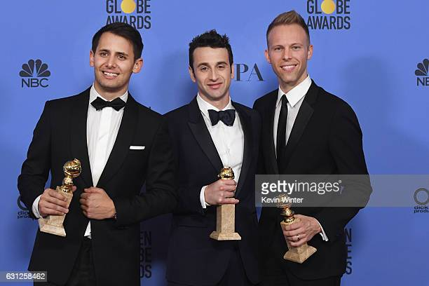 Songwriters Benj Pasek Justin Hurwitz and Justin Paul winners of Best Original Song for 'City of Stars' from 'La La Land' pose in the press room...