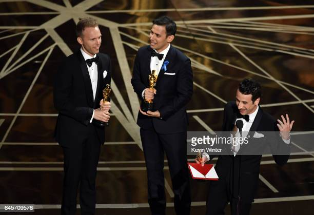Songwriters Justin Paul Benj Pasek and Justin Hurwitz accept Best Original Song for 'City of Stars' from 'La La Land' onstage during the 89th Annual...