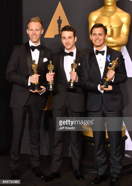Songwriters Justin Paul Justin Hurwitz Benj Pasek winners of the Best Original Song award for 'City of Stars' from 'La La Land' pose in the press...