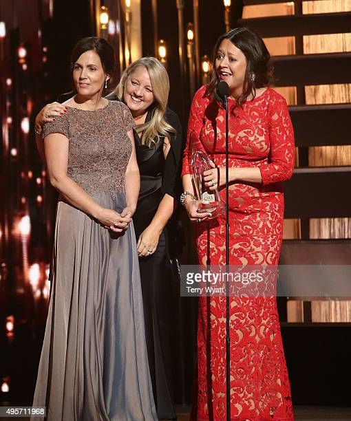 Songwriters Liz Rose Hillary Lindsey and Lori McKenna accept the award for Song of the Year for the song 'Girl Crush' onstage at the 49th annual CMA...