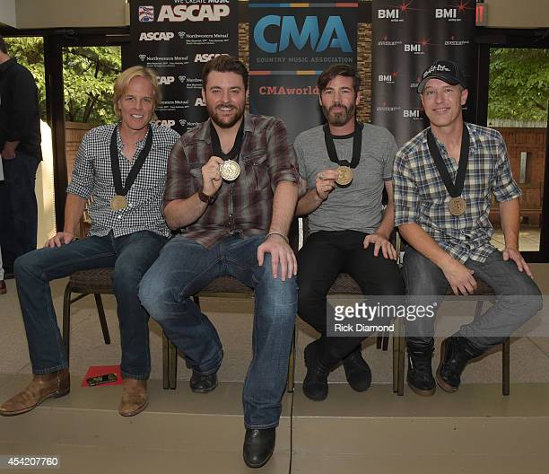 Songwriters Marv Green Paul Jenkins Jason Sellers join Singer/Songwriter Chris Young to Celebrates their Single 'Who I Am With You' on August 25 2014...