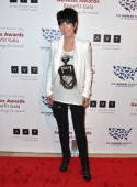 Songwwriter Diane Warren arrives to the 2013 Genesis Awards Benefit Gala at The Beverly Hilton Hotel on March 23 2013 in Beverly Hills California