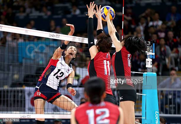 SongYi Han of Korea spikes the ball against Ai Otomo of Japan during the Women's Volleyball on Day 15 of the London 2012 Olympic Games at Earls Court...