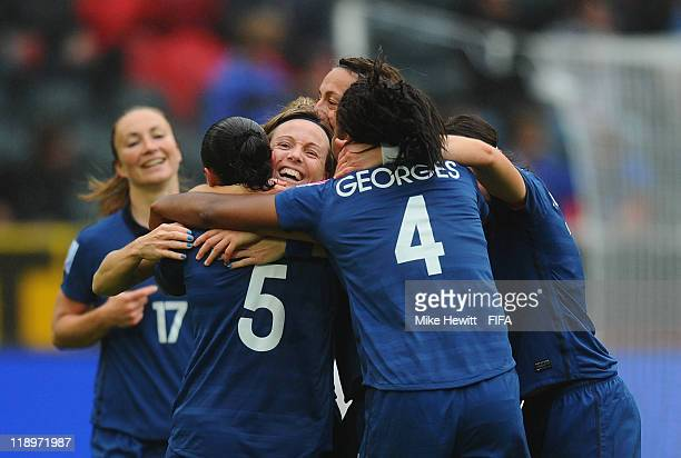 Sonia Bompastor is mobbed by team mates after equalising during the FIFA Women's World Cup 2011 Semi Final between France and USA at BorussiaPark...