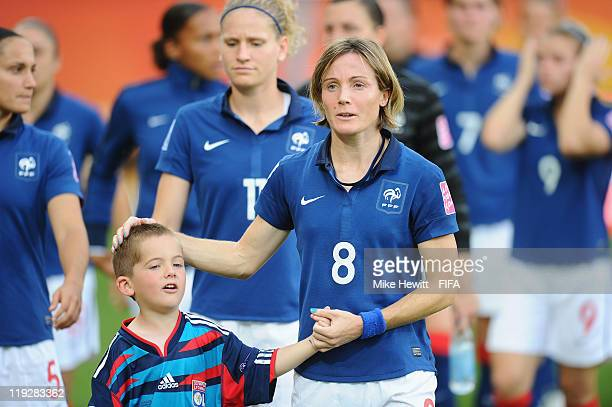 Sonia Bompastor of France and the dejected France team leaves the field after the FIFA Women's World Cup 2011 3rd Place Playoff between Sweden and...