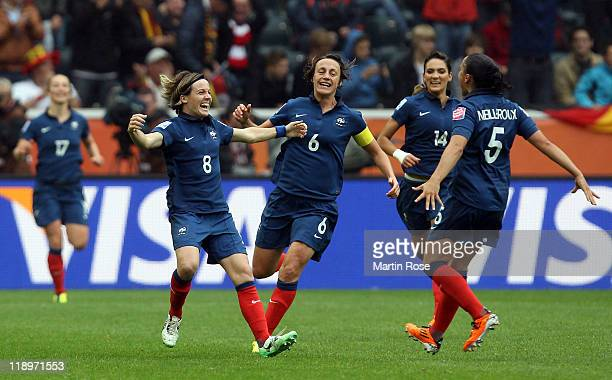 Sonia Bompastor of France celebrates after she scores her team's equalizing goal during the FIFA Women's World Cup 2011 Semi Final match between...