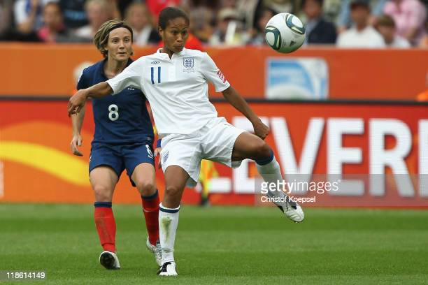 Sonia Bompastor of France challenges Rachel Yankey of England during the FIFA Women's World Cup 2011 Quarter Final match between England and France...