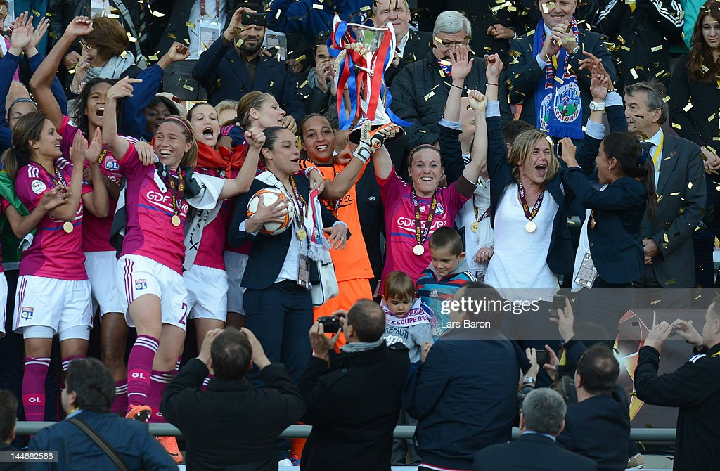 Sonia Bompastor of Olympique Lyonnais lifts the trophy and celebrates with team mates after winning the UEFA Women's Champions League Final at Olympiastadion on May 17, 2012 in Munich, Germany.