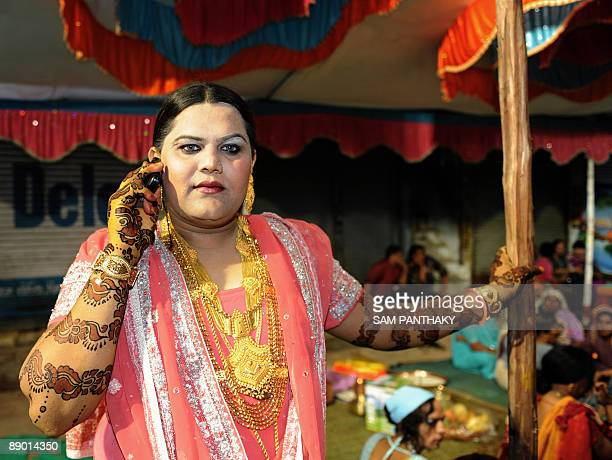 Sonia De President of Gujarat state Kinnar Association speaks on a cellualr telephone prior to the start of a wedding reception in Ahmedabad on July...