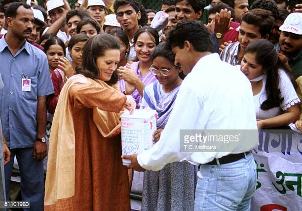 Sonia Gandhi President Of India's Main Opposition Congress Party Puts Money Into A Box As She Launches A ThreeDay Campaign To Collect Donations In...