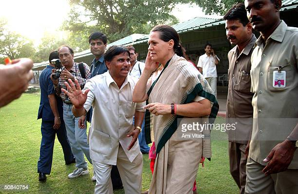 Sonia Gandhi walks over to supporters after being elected Congress Party leader May 15 2004 in New Delhi India Congress' election of Ghandi as its...