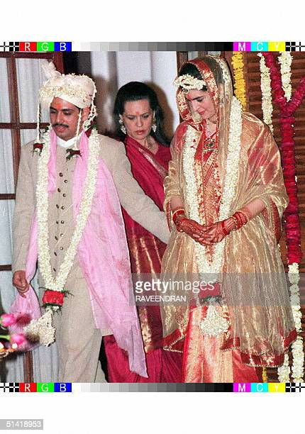 Sonia Gandhi widow of slain former Indian Prime Minister stands with her newlywed daughter Priyanka and groom Robert Vadra 18 February after their...