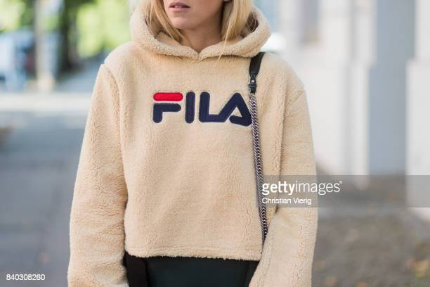 Sonia Lyson wearing a beige fleece fake teddy cropped Fila hoody black green KAN I Fendi bag a fendi skirt on August 28 2017 in Berlin Germany