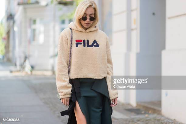 Sonia Lyson wearing a beige fleece fake teddy cropped Fila hoody velvet pumps Jimmy Choo black green KAN I Fendi bag a fendi skirt Ray Ban sunglasses...