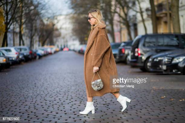 Sonia Lyson wearing a brown teddy coat Max Mara Gigi Hadid x Vogue Eyewear sunglasses white lack boots Edited yellow skirt with animal print Edited...