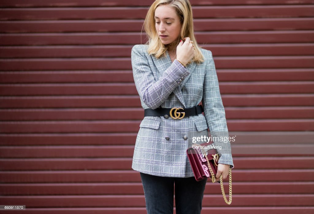 Sonia Lyson wearing a grey checked blazer jacket Zara, a black Gucci belt, flared cropped denim jeans Mother Denim, shoes Aeyde, bag Pinco on June 8, 2017 in Berlin, Germany.