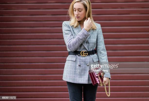 Sonia Lyson wearing a grey checked blazer jacket Zara a black Gucci belt flared cropped denim jeans Mother Denim shoes Aeyde bag Pinco on June 8 2017...