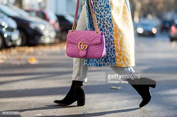 Sonia Lyson wearing a yellow blue green wool coat with leo print from Acne via Voostore Acne denim jeans black Lala Berlin heeled ankle boots pink...