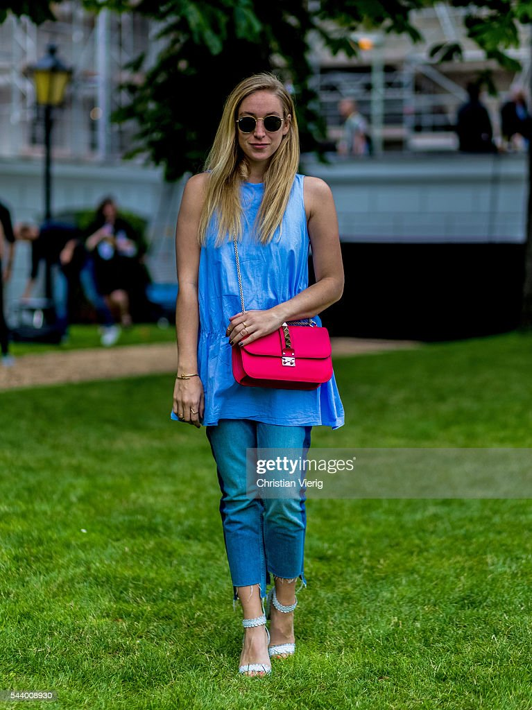 Sonia Lyson wearing a Zara dress, a red Valentino bag, Tabitha Simons shoes outside Marina Hoermanseder during the Mercedes-Benz Fashion Week Berlin Spring/Summer 2017 on June 30, 2016 in Berlin, Germany.