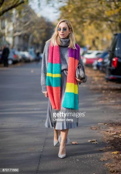 Sonia Lyson wearing grey Jimmy Choo wild leder pumps with furs grey Zara midi pleated skirt multi colour scarf Zara grey turtleneck knit Zara Ray Ban...