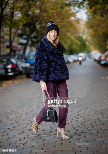 Sonia Lyson wearing Jimmy Choo boots with snake skin print navy fake fur cropped jacket Nobi Talai bordeaux pleated trousers Nobi Talai wool beanie...