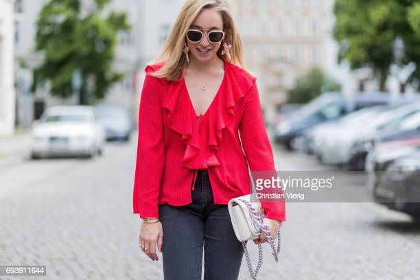 Sonia Lyson wearing red sandro slipper sandals Sandro flared cropped denim jeans mother denim red top topshop Miu Miu bag sunglasses other stories...