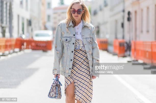 Sonia Lyson wearing velvet mules Raye via Revolve plaid Topshop skirt with slit tshirt Zoe Karssen denim jacket Alexander Wang MCM sunglasses a Fendi...