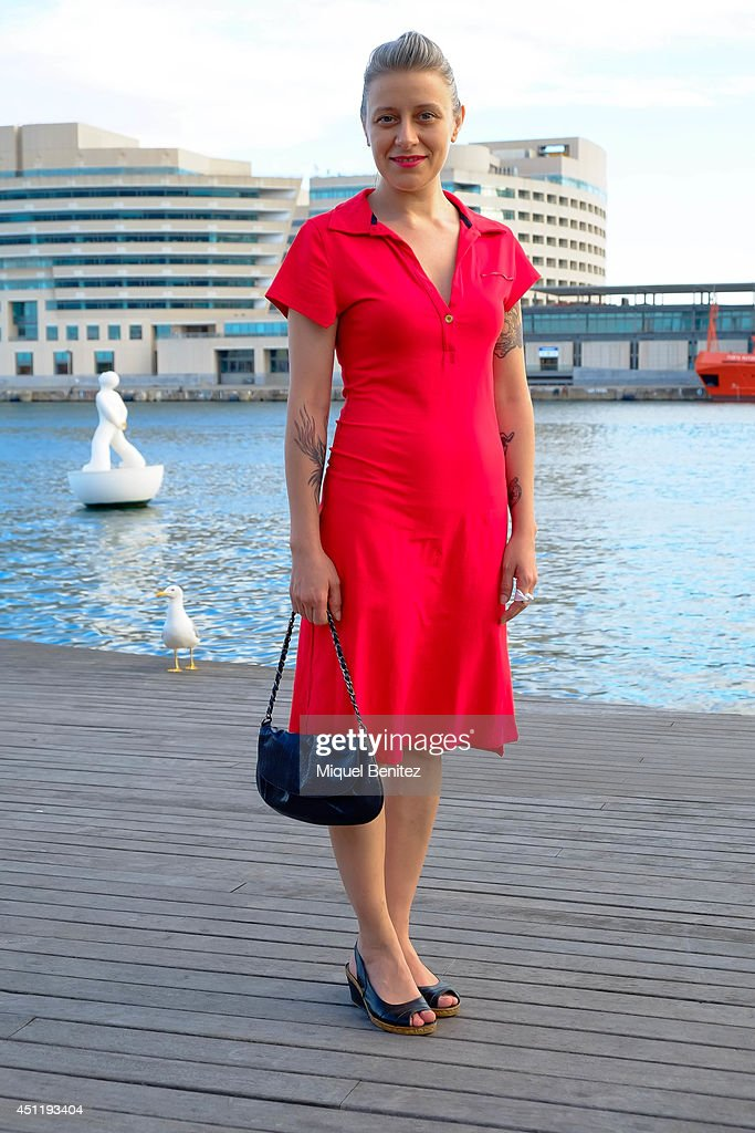 Sonia Martinez from Spain seen wearing a red dress purchased at a flea market and customized by herself, a handbag from an oulet and Querolets shoes on June 25, 2014 in Barcelona, Spain.