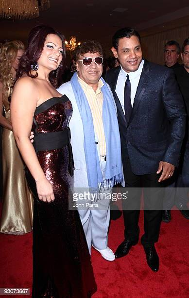 Sonia Sosa Juan Gabriel and Sammy Sosa pose together at Sammy Sosa birthday party at Fontainebleau Miami Beach on November 14 2009 in Miami Beach...