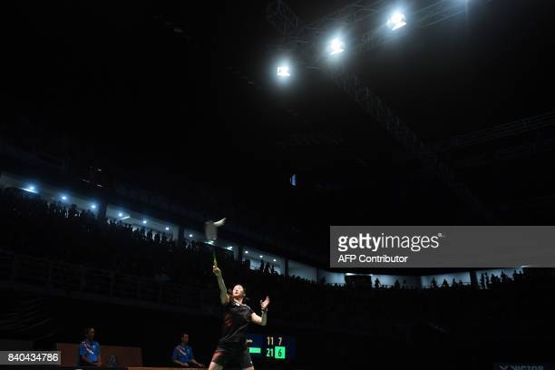 Soniia Cheah of Malaysia hits a return against Goh Jin Wei of Malaysia during the women's singles badminton final at the 29th Southeast Asian Games...