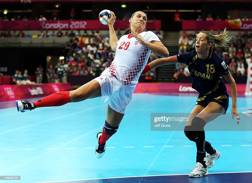 Sonja Basic #29 of Croatia shoots while defended by Begona Fernandez Molinos #18 of Spain during the Women's Quarterfinal match between Spain and Croatia on Day 11 of the London 2012 Olympic Games at The Copper Box on August 7, 2012 in London, England.
