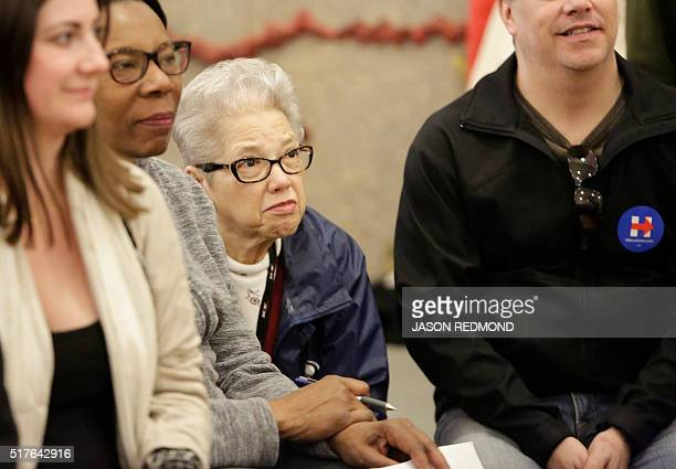 Sonja CookSewart listens as people talk about their candidate choices during Washington State Democratic Caucuses at Martin Luther King Elementary...