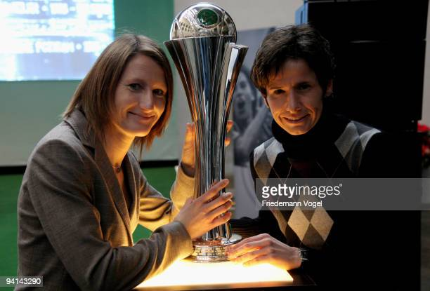 Sonja Fuss and Bettina Wiegmann pose with the trophy during the German Football Association women trophy presentation at the Cologne guildhall on...