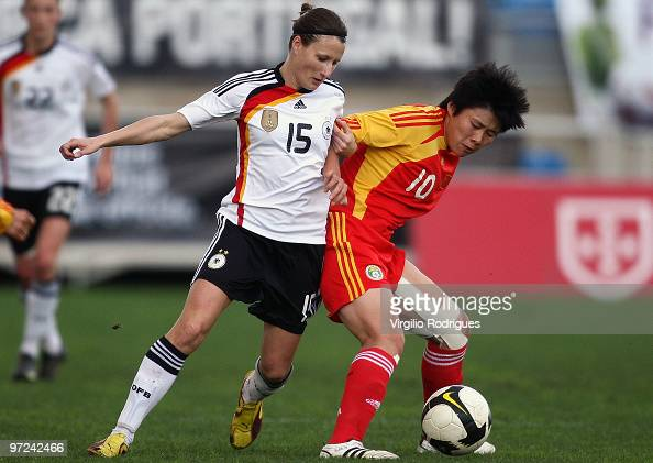 Sonja Fuss of Germany and Ma Xiaoxu of China battle for the ball during the Woman Algarve Cup match between Germany and China at the Estadio Algarve...