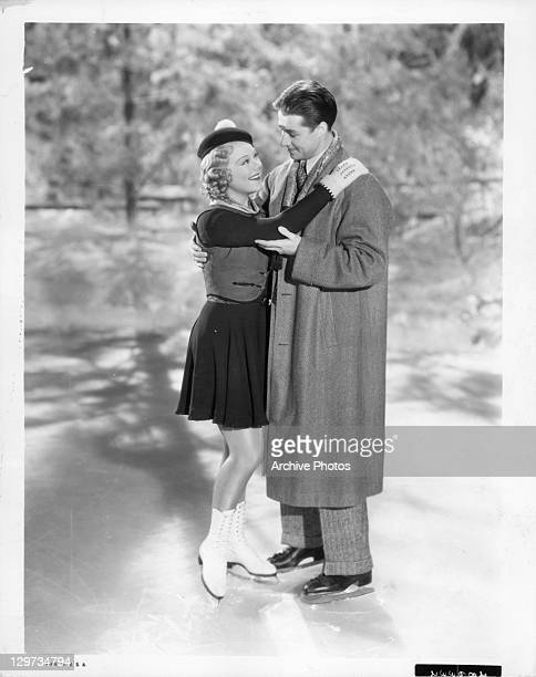 Sonja Henie and Don Ameche hold each other on frozen pond in a scene from the film 'Happy Landing' 1938