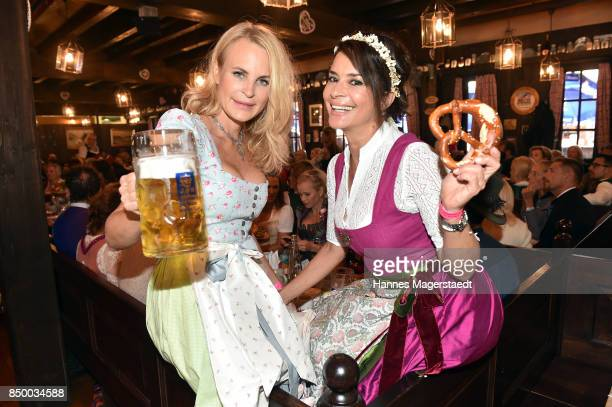 Sonja Kiefer and Gitta Saxx attend the Charity Lunch at 'Zur Bratwurst' during the Oktoberfest 2017 on September 20 2017 in Munich Germany