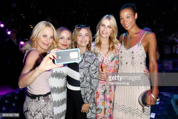 Sonja Kiefer Regina Halmich Tina Ruland Tanja Buelter and Annabelle Mandeng attend the Guido Maria Kretschmer Fashion Show Autumn/Winter 2017...