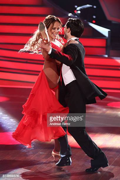 Sonja Kirchberger and Ilia Russo perform on stage during the 1st show of the television competition 'Let's Dance' on March 11 2016 in Cologne Germany