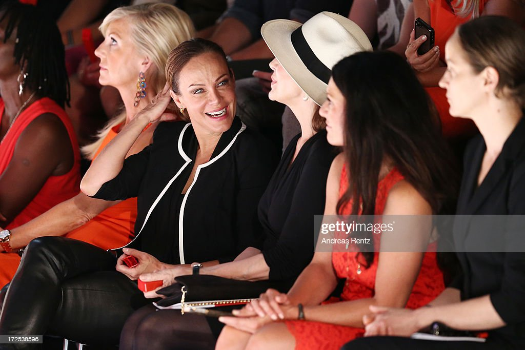 Sonja Kirchberger (2ndL) laughs at the Minx By Eva Lutz Show during the Mercedes-Benz Fashion Week Spring/Summer 2014 at the Brandenburg Gate on July 3, 2013 in Berlin, Germany.