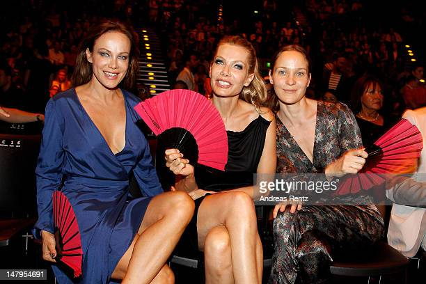Sonja Kirchberger Ursula Karven and Jeanette Hain sit in front row during the Michalsky Style Nite 2012 at MercedesBenz Fashion Week Berlin...
