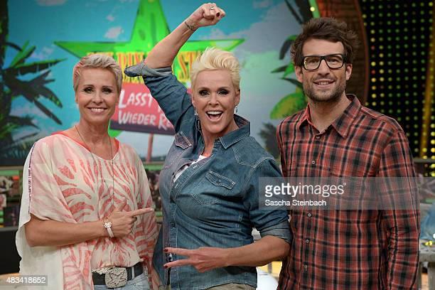 Sonja Zietlow Brigitte Nielsen and Daniel Hartwich pose after the final of the television show 'Ich bin ein Star lasst mich wieder rein' on August 8...