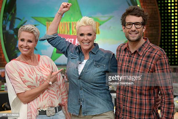 Sonja Zietlow Brigitte Nielsen and Daniel Hartwich pose after the final of the television show 'Ich bin ein Star lasst mich wieder rein' on August 8...